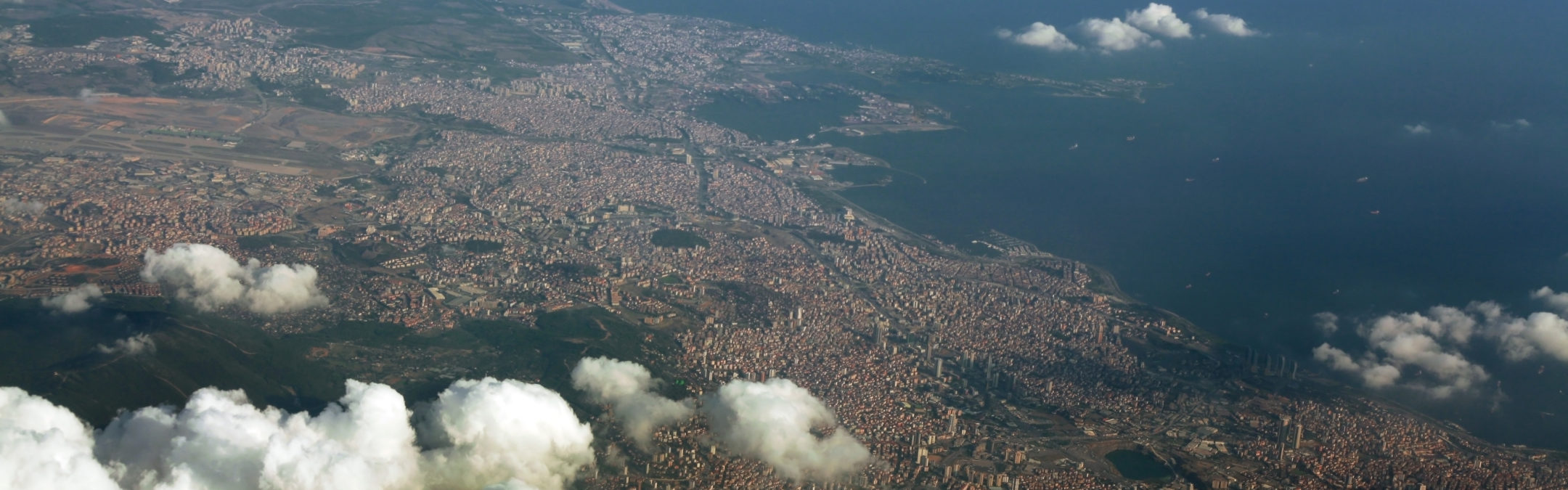 Istanbul under white partial clouds, with over 17 million population through a Bird's Eye View.